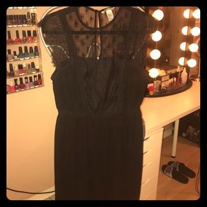 Black dress with lace upper detail.